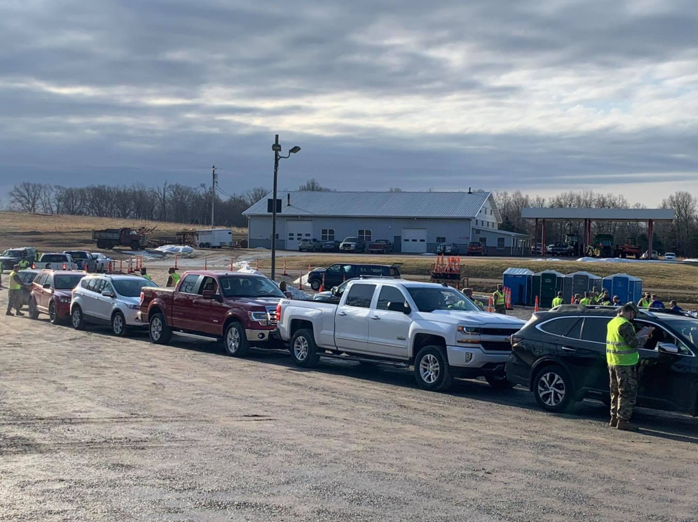 Cars line up at a mass vaccination event at the Knights of Columbus Hall in Leopold on Feb. 24, 2021.