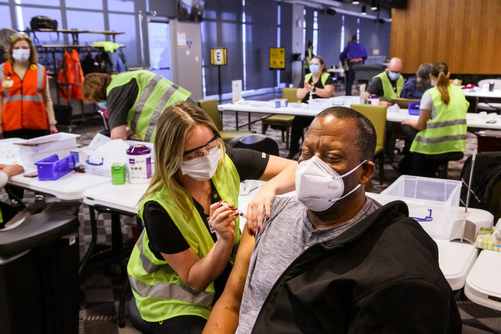 University of Missouri Sinclair School of Nursing student Hannah Tipton administers a COVID-19 vaccine to Clifford Nevins during MU Health Care's vaccination clinic in the Walsworth Family Columns Club