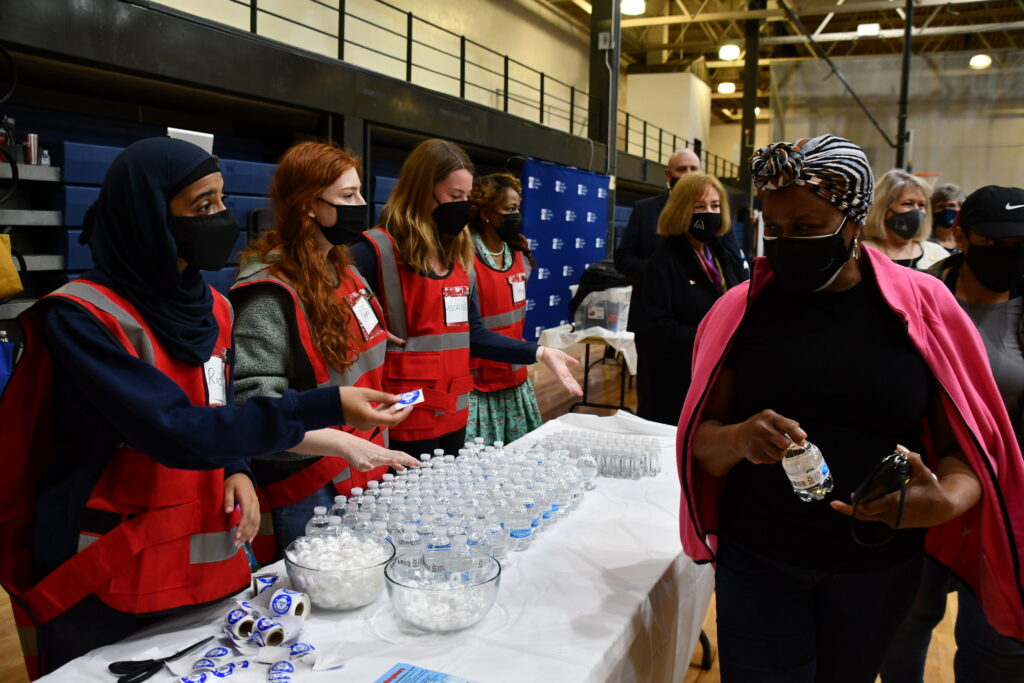 Vaccines are administered at a mega vaccination event at St. Louis Community College
