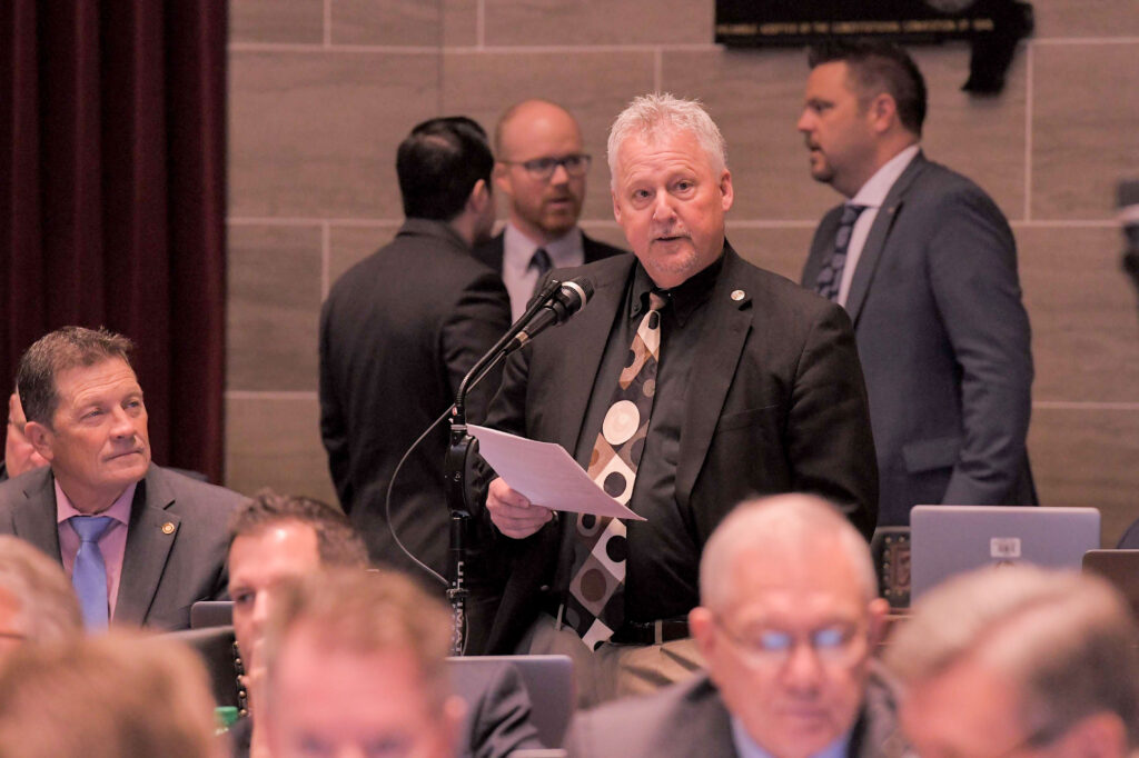 Rep. Brad Pollitt on the House floor.