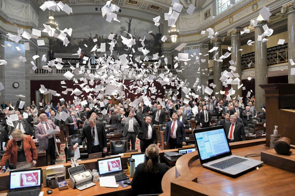 Members of the Missouri House of Representatives celebrate the close of the 2021 legislative session