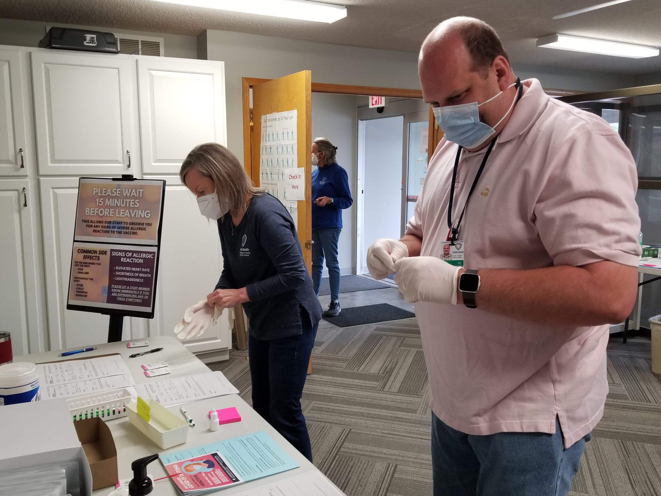 Nurse Anita Perry, left, and Curtis Lanning, emergency coordinator, process samples Friday during a drive-up COVID-19 testing event at the Livingston County Health Center in Chillicothe. (Rudi Keller/Missouri Independent)