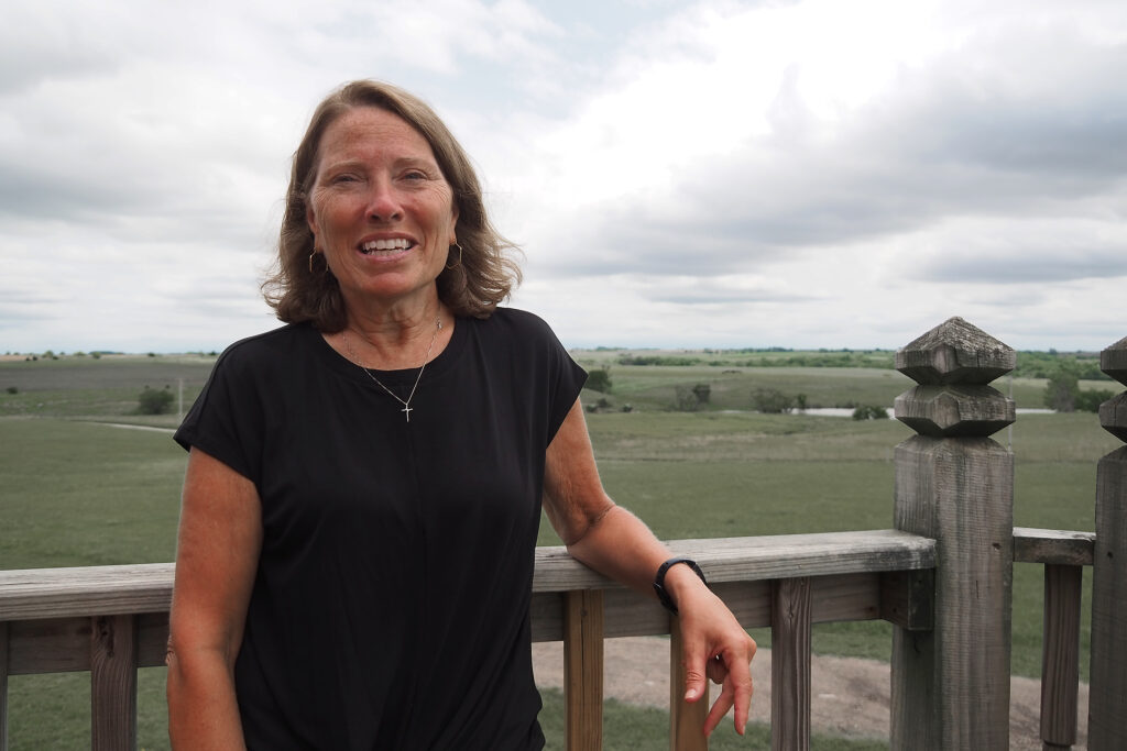 The deck of Carol Hull's family's barn has panoramic views of the gently rolling terrain in Marshall County, Kansas.