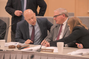 House Budget Chairman Cody Smith, left, and Senate Appropriations Chairman Dan Hegeman confer with legislative staff during a conference committee hearing on the state budget on May, 5, 2021