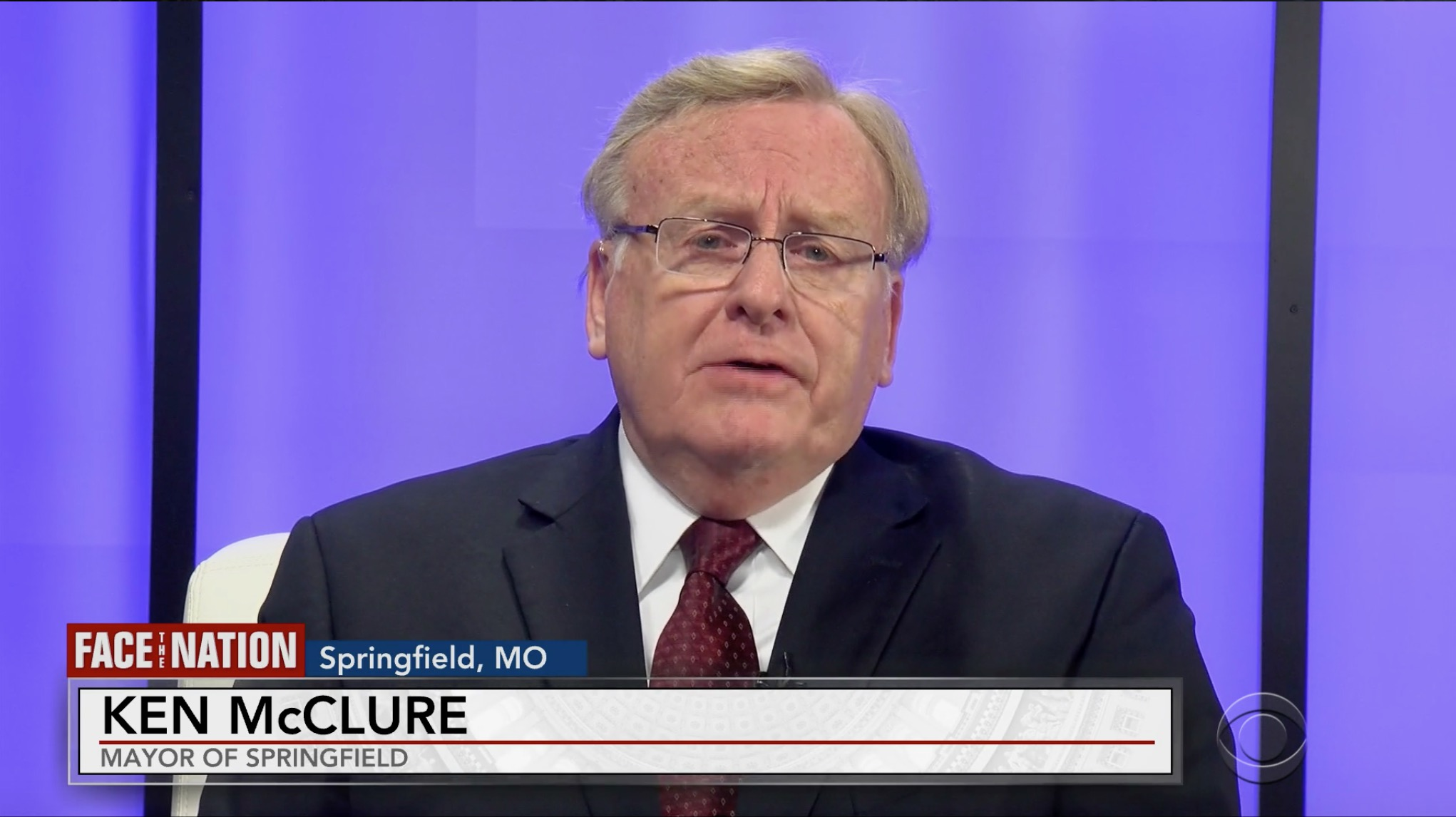 Springfield Mayor Ken McClure speaking against a purple background with his name and title placed at the bottom of the image.