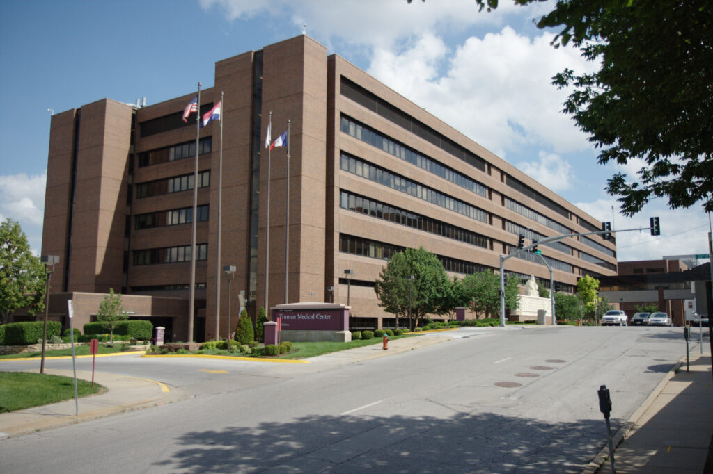 A photo of Truman Medical Center in Kansas City showing the six-story hospital on a sunny day.