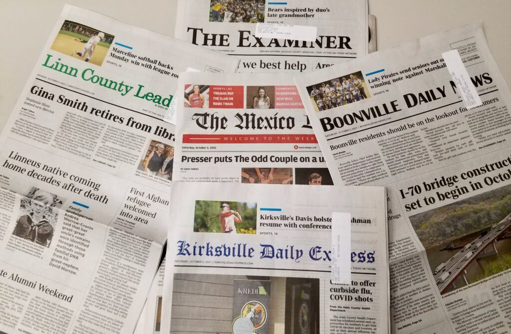Five newspapers arranged so the mastheads are all readable to illustrate newspapers that have been sold in the past year by Gannett.